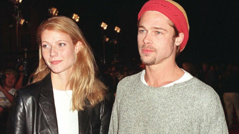 Gwyneth Paltrow w skórzanej kurtce i Brad Pitt w dzierganej czapce trzymają się za ręce
