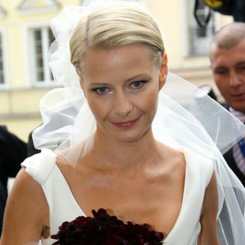 Małgorzata Kożuchowska w sukni ślubnej i welonie